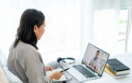 back-view-woman-making-video-call-with-her-doctor-with-her-feeling-sick_73503-2457